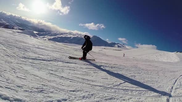 Thumbnail for A young man skiing.