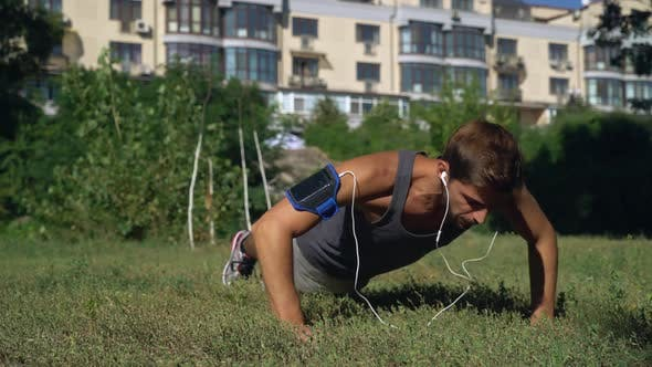 Thumbnail for Young Boy Athlete Squeezed in a Park Near the House