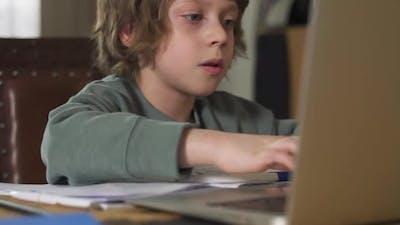 Schoolboy Pupil Talking to Internet Teacher Via Laptop Spbd