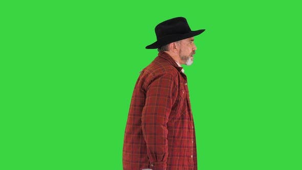 Thumbnail for Elderly Caucasian Cowboy in a Hat Walking on a Green Screen Chroma Key