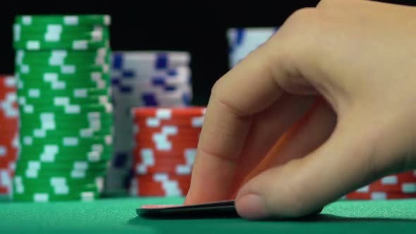Thumbnail for Poker player showing one pair of sevens, lucky number, winning hand. Slow motion