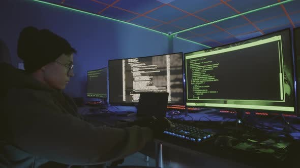Thumbnail for Asian Programmer Working at Night