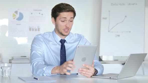 Thumbnail for Online Video Chat on Tablet by Businessman