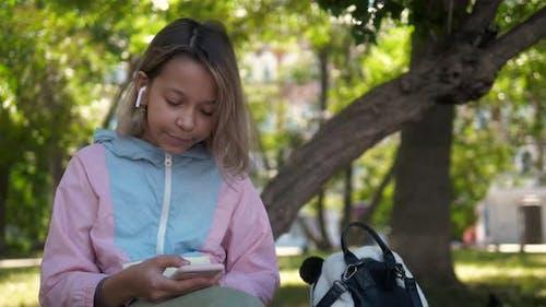 Kid Using Smartwatch or Smart Watch, School Kid with Smartwatch Child Using Smartwatch on Her Wrist