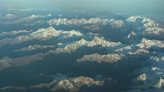 Thumbnail for Beautiful View Through Airplane Window, Airplane Flying Above the Mountains with Clouds
