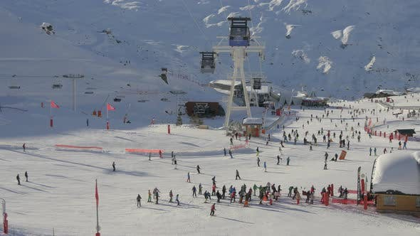 Thumbnail for People skiing at a ski resort