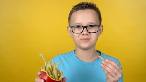 Thumbnail for Boy in Glasses Eating Fries