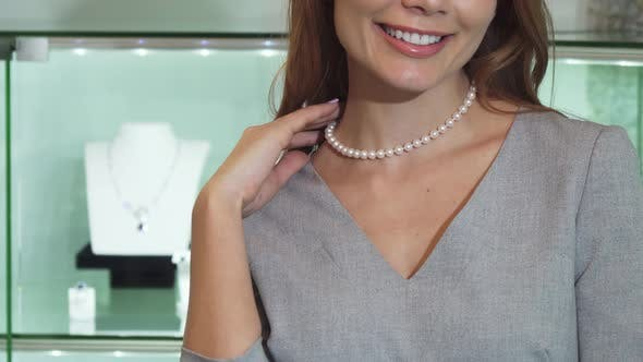 Thumbnail for Happy Woman Smiling Wearing Pearl Necklace