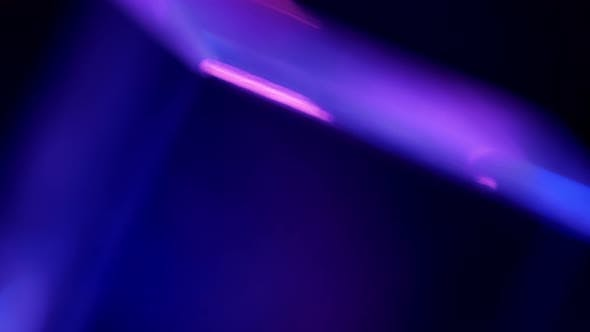 Lights Glare and Rays in Pink, Purple and Blue Abstract. Natural Crystal Light