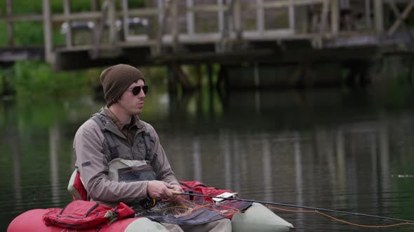 Thumbnail for Fly fisherman fishing from float tube