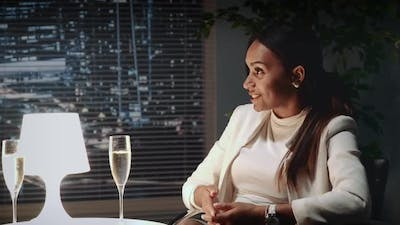 African American Business Lady Making Cheers at Business Meeting