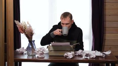 Male Journalist Writes on a Typewriter