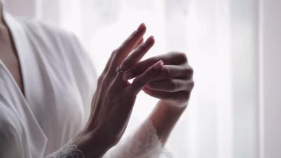Bride in Night Gown Veil with Engagement Ring Near Window