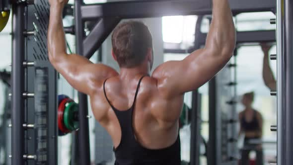 Thumbnail for Man Doing Pull Ups in Gym