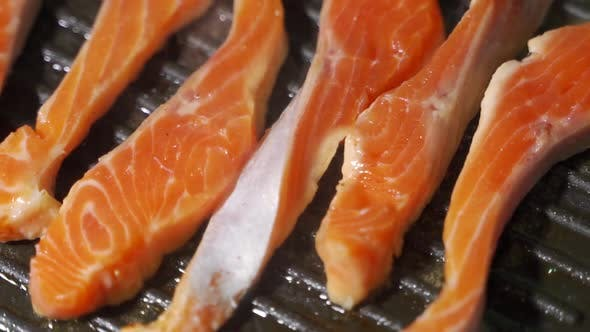 Thumbnail for Homemade Fish Meal. Piece of Salmon or Trout Fillet Frying on Grilled Pan.