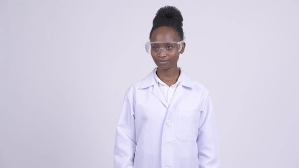 Thumbnail for Young Happy African Woman Doctor with Protective Glasses Thinking