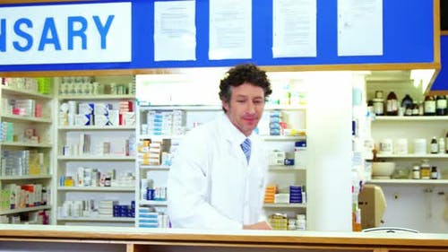 Pharmacist checking a medicine in pharmacy