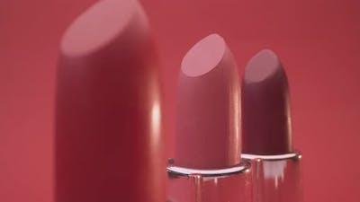Lipsticks against Red Background