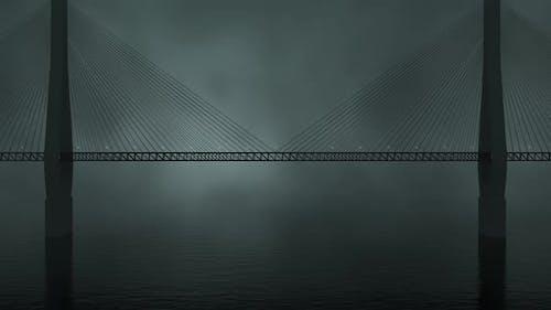Suspension bridge in the foggy night