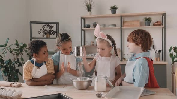 Diverse School Kids Playing with Flour