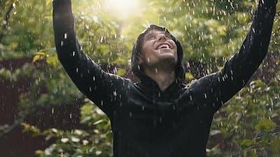 Happy Man Under Rain Raising Hands