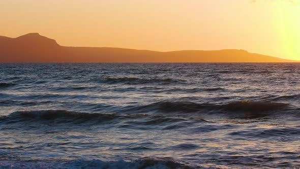 Natural Dramatic Seascape Sunrise with Mountains Sunset Sun Shining Through Golden Waves Ocean and