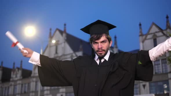 Thumbnail for Young Male College Graduate Dancing