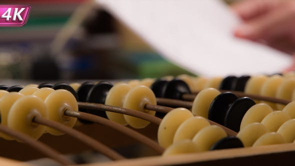 Thumbnail for Man Uses Vintage Old Abacus
