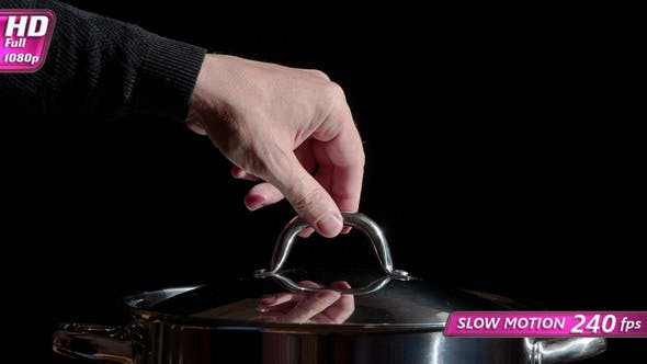 Cook Picks Up The Lid From The Pan