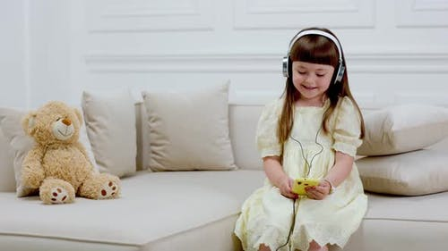 Girl with Headphones Singing a Song