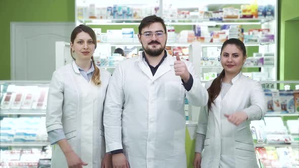 Thumbnail for Three Young Caucasian Pharmacists Showing Thumbs Up To the Camera and Smiling. Highly Professional