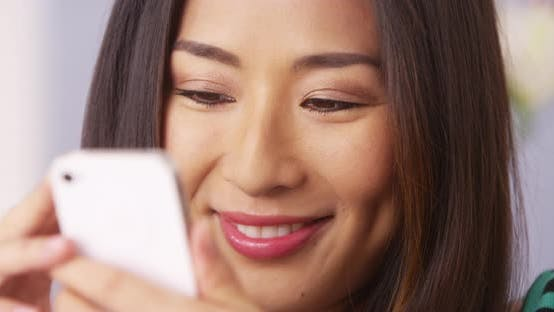 Thumbnail for Close up of Japanese woman using smartphone