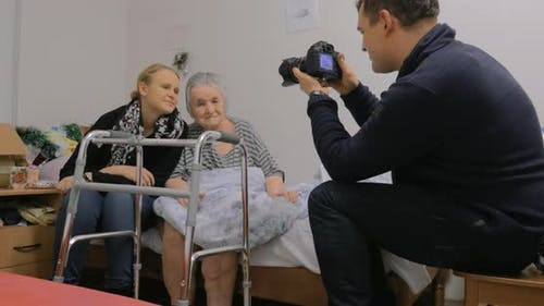 Visiting elderly grandma and making photos with her