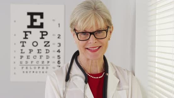 Senior woman optometrist smiling