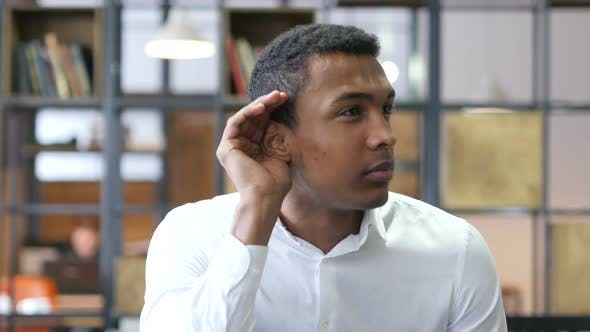 Cover Image for Black Man Listening Carefully in Office
