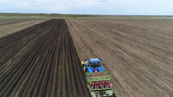 Thumbnail for Aerial view of a blue tractor plant potatoes