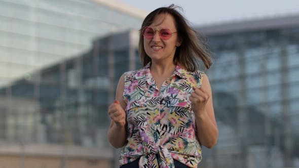 Thumbnail for Angry Mad Woman Tourist in Trendy Sunglasses Raising Fists, Looking at Camera with Furious Face