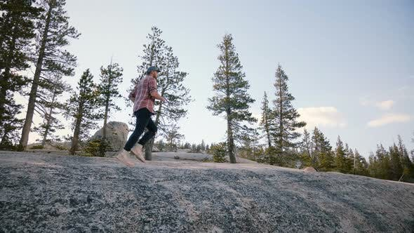 Thumbnail for Young Man Running Up a Giant Rock While Hiking Alone