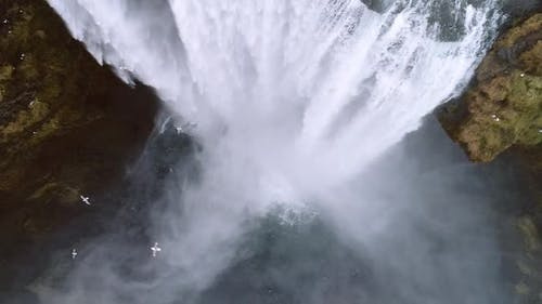 Aerial flight over Skogar waterfall, Iceland