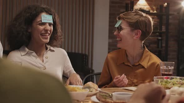 Thumbnail for Friends Laughing while Playing Game in Restaurant