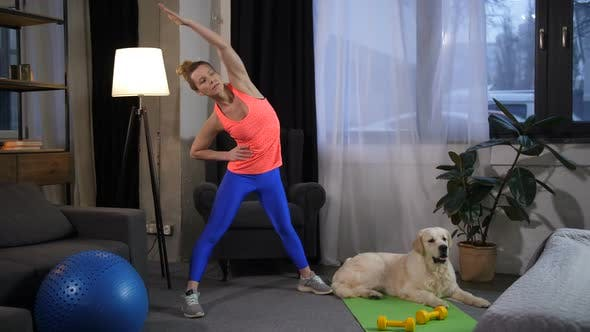Thumbnail for Sporty Fit Woman Exercising with Best Friend Dog