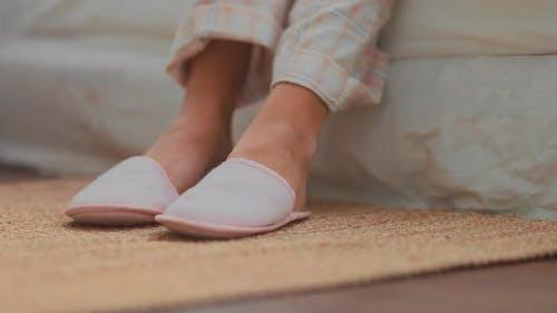 Slippers Put on Bare Feet