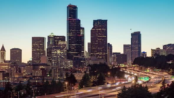 Thumbnail for Evening Time Lapse Downtown Seattle Skyline Brightly Lit With Car Lights