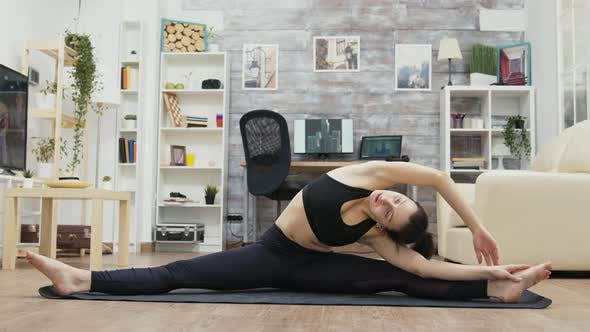 Flexible Young Woman Standing in Slip on Yoga Mat