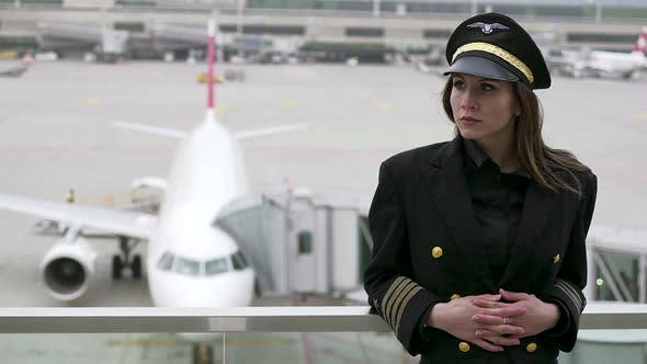 Thumbnail for Professional Female Pilot in Uniform at Airport