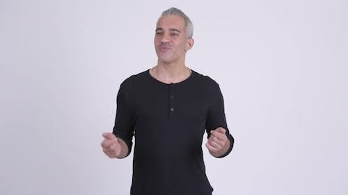 Happy Handsome Persian Man Talking Against White Background
