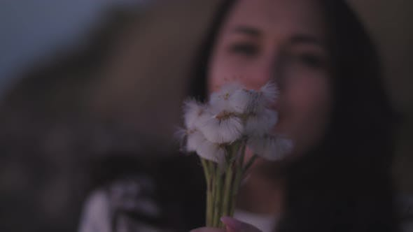 Thumbnail for Girl Blowing on Dandelions