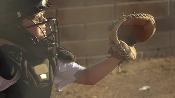 Thumbnail for A boy plays catcher in a little league baseball game.
