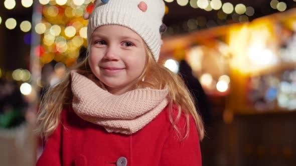 Thumbnail for Portrait of Happy Little Girl at Christmas Market