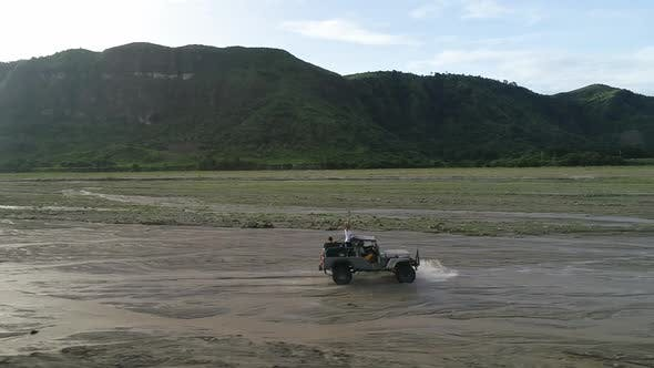 Thumbnail for Aerial view of road in valley with a off road jeep in Tarlac, Philippines.